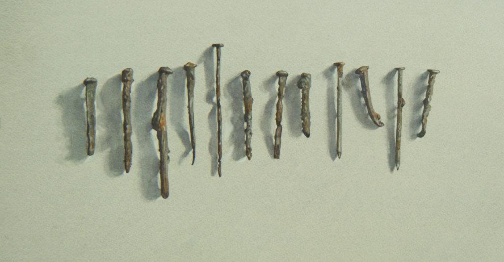 A dozen rusty nails 23 x 44cm